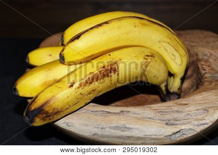 Close-up Of Ripe Yellow Bananas In A Wooden Bowl. Torfhaus, Germany