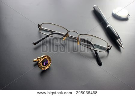 Still Life, Business, Office Supplies Or Education Concept: A View Of A Recumbent Padding, Glasses,