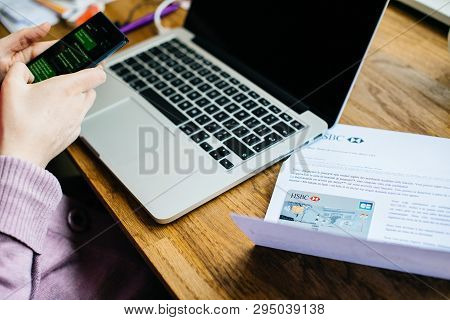 Paris, France - Apr 9, 2017: Woman Activating On The Smartphone Her New Hsbc French Division Featuri