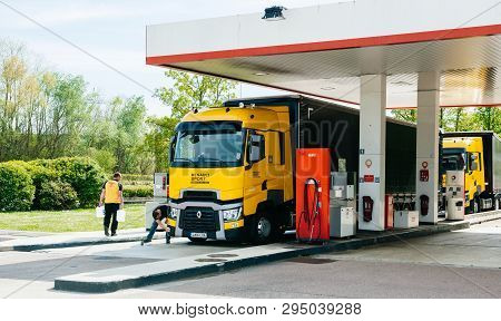 Nice, France - May 7, 2016: Two People Near New Modern Renault T520 Yellow Truck From The Formula On