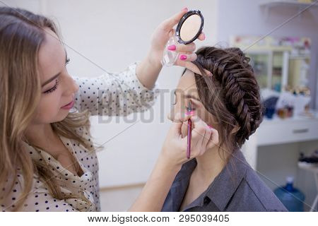 The Work Of A Professional Makeup Artist. Stylist Makeup Artist Doing Makeup And Hair In A Beauty Sa