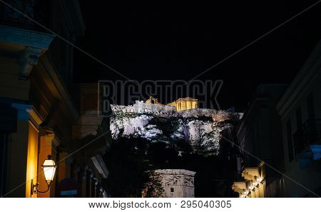 Illuminated Acropolis Monument In Central Athens At Night View From Below Postcard Image Like