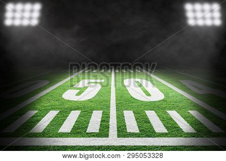 Close Up Of American Football Field With Stadium Spotlight On Specific 50 Yard Markings And Backgrou