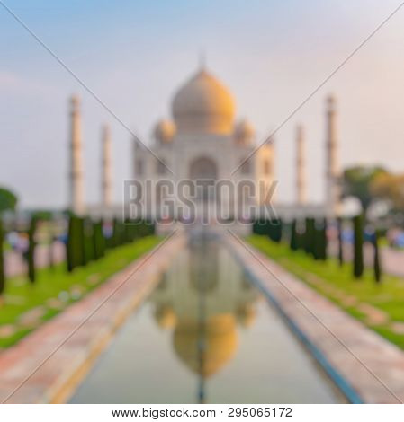 Out Of Focus Of Taj Mahal Front View Reflected On The Reflection Pool, An Ivory-white Marble Mausole