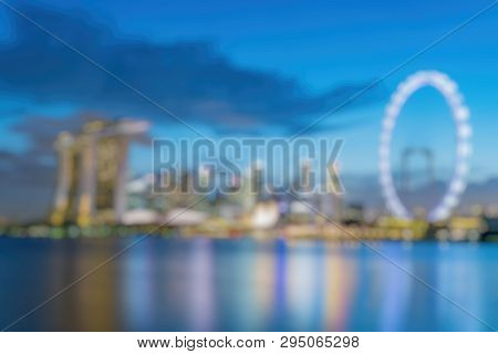 Out Of Focus Of Singapore Business District Skyline At Marina Bay On Twilight Time.