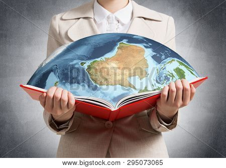 Woman Showing Earth Globe In Open Book. Global Ecology Concept. Elegant Young Woman In White Busines