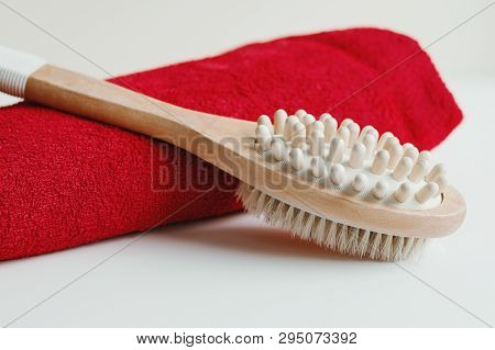 Wooden Brush For Dry Body Massage And Red Cotton Towel On White Background. Cellulite Treatment. Sel