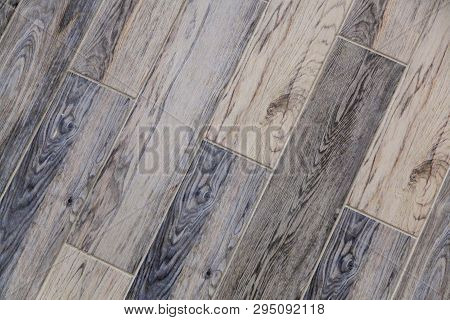 Modern Vinyl Floor With Old Wood Imitation. Close-up Of New Gray Flooring With Texture From Tiles Wi