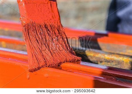 Paint Application By Brush On Metal Structures. Protective Coating Of Steel Closed Profiles With Pri
