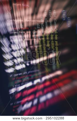 Website HTML Code on the Laptop Display Closeup Photo. Desktop PC monitor photo. poster
