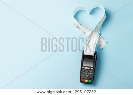 Terminal Cash Register Machine Pos For Payments And Long Roll Paper Cash Tape In Heart Shaped On Blu