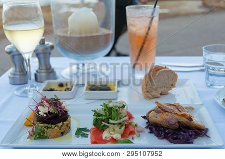 Entree Plate Of Duck Confit, Smoked Salmon And Quinoa With Beetroot And Feta. Fine Dining Food Styli