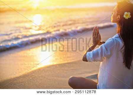 Yoga Concept. Woman Practicing Lotus Pose on Beach