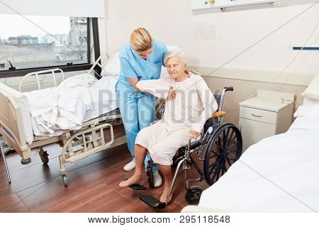 Nursing lady cares for elderly woman with wheelchair in nursing home or hospital