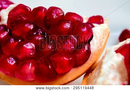 Detail Of Red Pomegranate Seeds On Pomegranate Seeds Pile As Fruit Background
