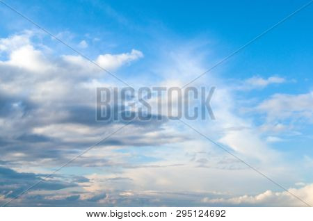 Blue sky landscape with dramatic colorful clouds and sunlight, vast sky background. Natural sky background, sky sunny landscape. Sunny sky background, blue sky with white clouds