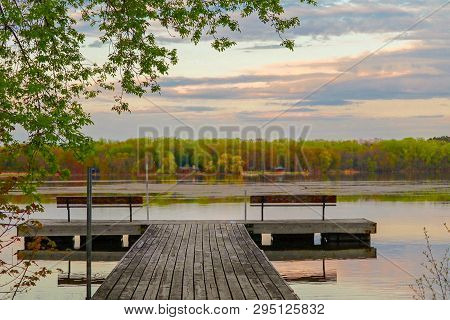 Scenic View Of The Sun Setting Over Staring Lake And A Fishing Dock  A Fishing Dock In Autumn