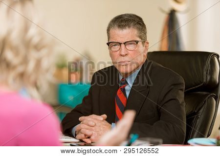 Professional Man Having A Discussion With A Colleague Or Client