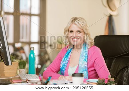 Happy Young Professional Woman In Her Office