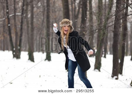 Outdoor Winter Portrait Of Woman In Snowball Fight