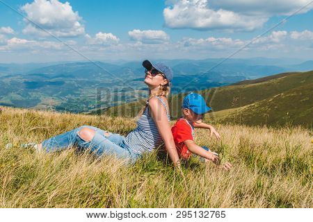 Mother With Son On Top Of Mountain. Beautiful Landscape View. Travel Hiking Concept