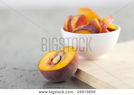 Close-up Of Sliced Peach On Rustic Table