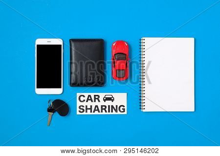 Car Sharing Concept. Composition With Driver's License, Blank Paper, Toy Car, Car Key And Text Sign
