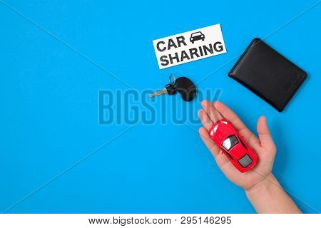 Car Sharing Concept With Toy Car In Human Hand, Auto Drive License, Car Key, Text Sign