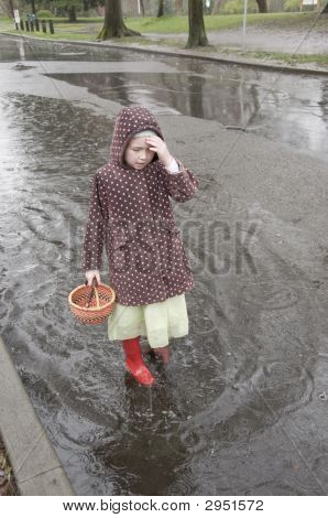 Girl Walking Through Puddle