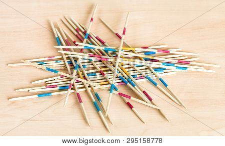 Pile From Wooden Sticks Of Mikado Pick-up Sticks Game On Wood Board