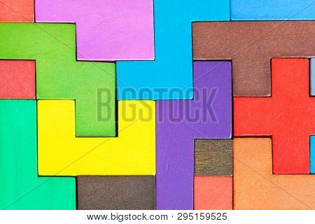 Background From Assembled Puzzle From Colored Wooden Pentominoes And Blocks