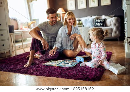 Young happy family with child at morning inside
