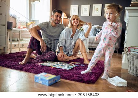 Young family with cute female child happy together