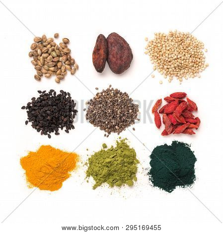 Small Heap Of Various Superfoods On White Background.superfood As Chia, Spirulina, Matcha Tea Powder