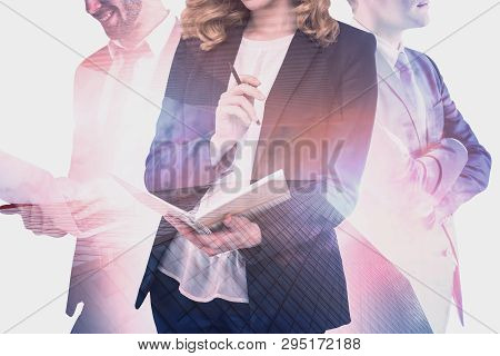 Unrecognizable Ginger Businesswoman, Her Colleague With Laptop And Their Confident Coworker Standing