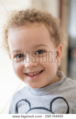 Portrait Of Lovely Boy Smiling In A Sunny Day