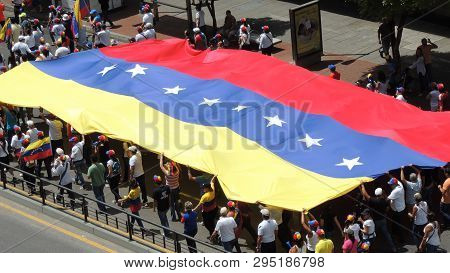 Protest For Freedom In Venezuela. Against Communism, Against Socialism. Students And People Protest