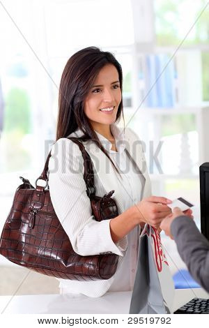 Beautiful modern woman buying with credit card