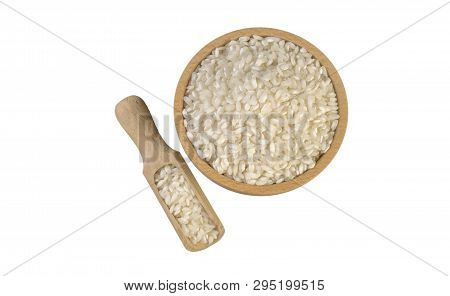 Arborio Risotto Short Grain Rice In Wooden Bowl And Scoop Isolated On White Background. Nutrition. B