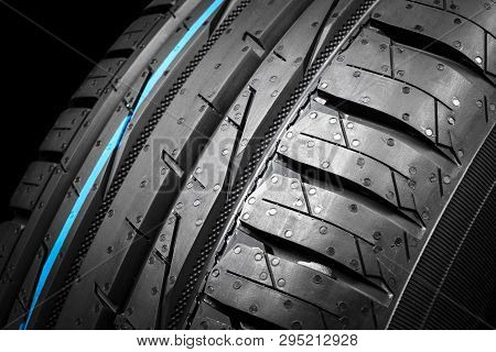 Car tire isolated on black background. Tire stack. Car tyre protector close up. Black rubber tire. Brand new car tires. Close up black tyre profile. poster