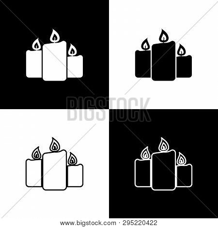 Set Burning Candles Icons Isolated On Black And White Background. Old Fashioned Lit Candles. Cylindr