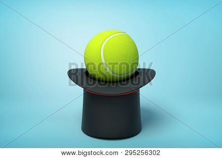 3d Rendering Of Black Tophat Upside Down With Tennis Ball Inside On Light-blue Background.