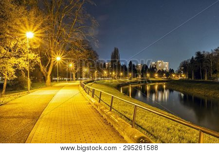 Evening Walking, Lantern And River, Nitra, Slovak Republic. Night Scene. Travel Destination.