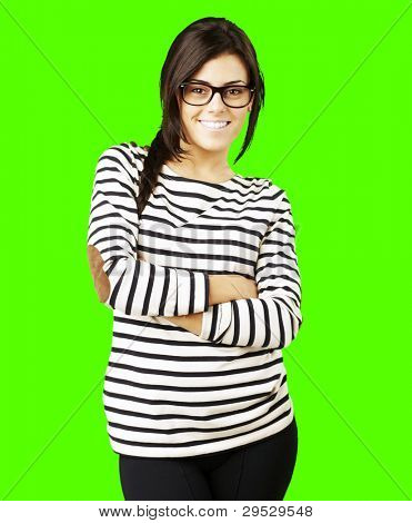 portrait of a young happy woman posing against a removable chroma key background