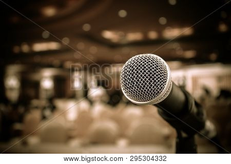 Microphones On Abstract Blurred Of Speech In Seminar Room Or Front Speaking Conference Hall, Blure L