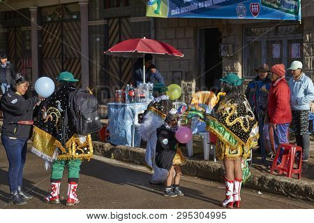 Oruro, Bolivia - February 26, 2017: Diablada Dancers In Ornate Costumes Prepare To Parade Through Th