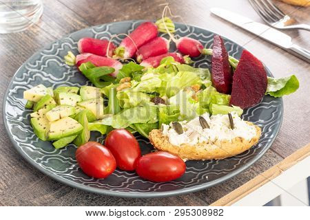 A Plate With Vegetarian Salad Of Natural Organic Vegetables