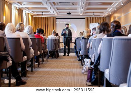 Speaker Giving A Talk At Conference, Presentation, Business Event. Audience At The Conference Hall.