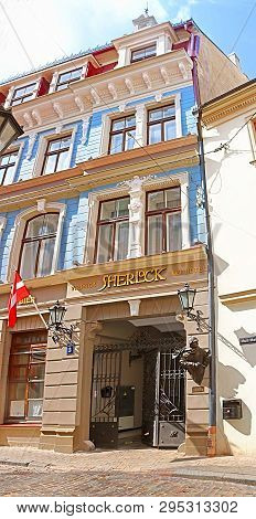 Riga, Latvia - August 29, 2018: The Sherlock Art Hotel And Monument To Sherlock Holmes