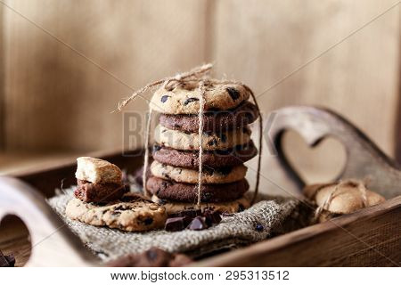 Chocolate Cookies On Wooden Rustic Table. Homemade Cookies. Stack Of Tasty Chocolate Cookies